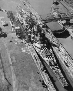 USS Missouri, one of the Iowa-class battleships, makes a very tight fit as she passes through the Miraflores Locks of the Panama Canal in October 1945.